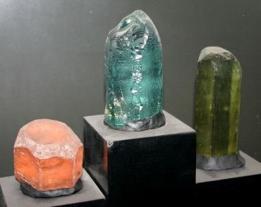 morganite to the left next to other beryl crystals