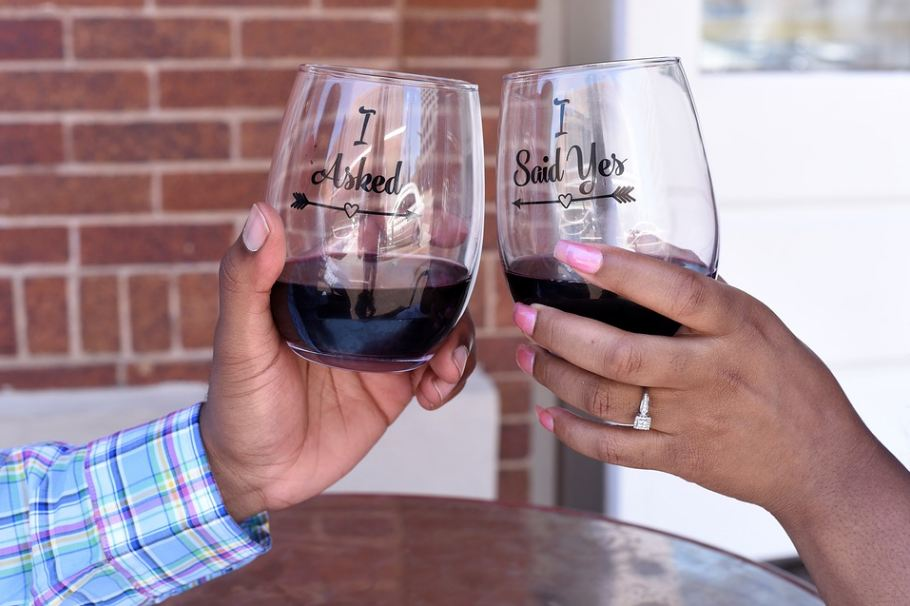 two wine glasses held by a couple